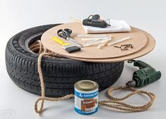 All you'll need for this amazing DIY ottoman are a tire, wood cut into circles, rope, screws, a screwdriver, a glue gun, a drill, a cloth, a brush, and a jar of sealant.