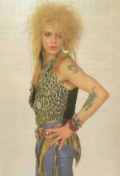 Michael Monroe of early 80s Finnish glam punk-metal band Hanoi Rocks, quite dolled up and effeminately pretty.