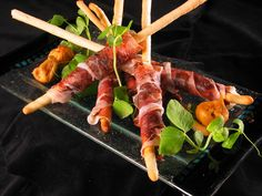 These prosciutto-wrapped breadsticks with fig dip are savoury, sweet and surprisingly simple. Impress your guests! gustotv.com/...