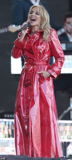 Glastonbury Festival Kylie Minogue headlines the music event 14 years after cancelling Red Raincoat, Raincoat Outfit, Plastic Raincoat, Hooded Raincoat, Vinyl Raincoat, Kylie Minogue, Vogue Uk, Imper Pvc, Pvc Coat