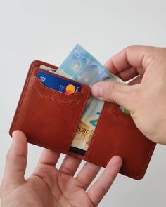 Ultra-Slim Bifold Wallet RFID-blocking technology Space for up to 8 cards Easily fits multiple unfolded paper notes One non RFID blocking slot on the back for the contactless loyalty card Dimensions: x x Handcrafted using premium leather Leather Diy Crafts, Leather Projects, Leather Craft, Men's Leather, Leather Wallet Pattern, Handmade Leather Wallet, Leather Money Clip Wallet, Crea Cuir, Minimalist Leather Wallet