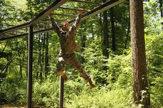 A cadet completes the Tarzan station during the obstacle course challenges at Cadet Field Training at West Point!