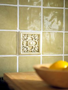 Using only a few decorative tiles in a wall installation saves money since most of the surface is covered by relatively inexpensive field tiles.
