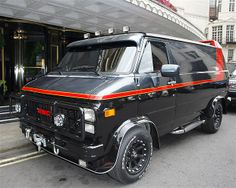 """One of two remaining vans that were used in the 1980s TV show """"The A-Team,"""" parked outside The Dorchester, a hotel in London, in July 2010."""