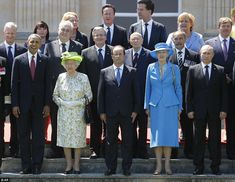 International pose: French President Francois Hollande (middle) stands with The Queen (second left) and other dignitaries for a photo outside the Chateau Benouville