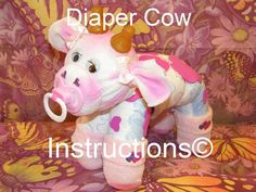 How to make a cow from Diapers. Diaper Cake Keepsake. GR8 baby shower gift, diaper cake topper, centerpiece, farm animal. via Etsy