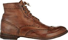 $389, Brown Leather Brogue Boots: Wingtip Boots by Officine Creative. Sold by Barneys Warehouse. Click for more info: http://lookastic.com/men/shop_items/231653/redirect