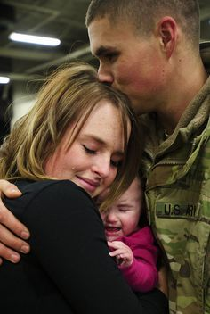 A Utah National Guard Soldier greets his wife and daughter after spending 9 months in Afghanistan.