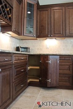 A Traditional Style Kitchen With Rope Crown Moulding; Glass Inserts, And A  Rich Wood Stain. Cabinets Shown Are Jasper RTA Bristol Maple Chocolate  Glaze.