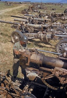 A U.S. soldier looks at the German artillery. Tunisia. 1943