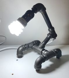 Black pipe lamp, medium base bulb (not included), 110V, thumbwheel switch, 10 x 9 x 7