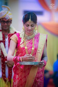Indian wedding photography. Couple photo shoot ideas. Candid photography. Traditional Southern Indian bride wearing bridal silk saree, jewellery and hairstyle. #IndianBridalMakeup #IndianBridalFashion