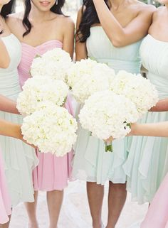 all white bouquets for bridesmaids to pull together diff. dresses