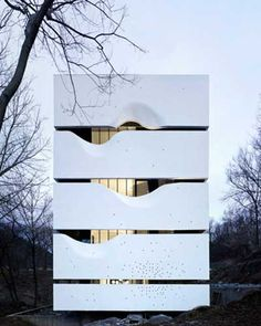 Zhang Lei of AZL Architects has designed a four storey house with layered concrete walls resembling Chinese scrolls