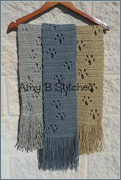 Have you been looking for a scarf pattern that shows off your love for animals without making you feel like you are wearing a childs design?? The Meandering Paw Prints scarf pattern fits that bill and will work for a Dog or Cat lover equally.