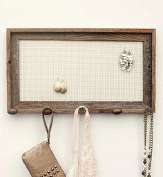 Cute organizer for scarves, belts, jewelry.  And I think this would be a great DIY project vs. spending money buying one.  I'm using this Barnwood jewelry holder, $68, etsy.com as a guide to making one of my own.