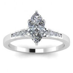Marquise Diamond Engagement Ring - Classy comes to mind with this incredible 14k White Gold Marquise Diamond Engagement Ring placed within a channel setting that features a White Marquise cut center stone along with 8 White Round cut accent side stones around the shank. This Marquise engagement ring comes with an I1 in clarity as well as a G in color. The total gem weight is equal to 1.0 carats. All of the diamonds are 100% natural. #unusualengagementrings