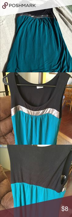 Dressy teal sleeveless top Gorgeous dark teal top with silver neckline accent. I paired it with the black capris also listed in my closet. Wore the outfit to a wedding and receive so many compliments! Only worn twice. Soft to the touch. 95% rayon and 5% spandex with a bubble hem that bunches at the bottom. Studio Y Tops Blouses