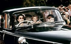 Queen Elizabeth II driving Prince Charles and Princess Anne (1957).