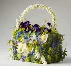 Botanical purse with lily-of-the-valley, hellebore, pansees, Muscari, Scilla… Art Floral, Design Floral, Floral Bags, Floral Purses, Floral Shoes, Bridesmaid Flowers, Bridal Flowers, Love Flowers, Spring Flowers