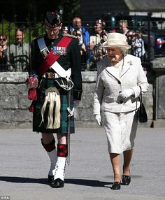 The Queen arrives at at Balmoral for her annual summer break, accompanied by Royal Guard Commander Major Dougie Watson