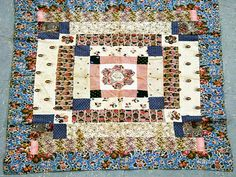"cot patchwork  coverlet measuring 84 x 98 cms.  The  central hexagon is embroidered with ""May thou be  blessed sweetest babe 1808"