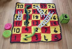 T-shirt yarn snakes and ladders by the incredibly talented Lynn Stott (My mum :-))