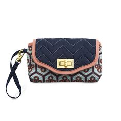 Uptown Wristlet - Sassy and stylish, the Uptown Wristlet makes it easy to carry your phone or camera, money and a lip gloss or two for a fun day of shopping or a fabulous night on the town.