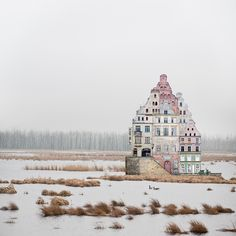 Using scissors and glue, artist Matthias Jung creates surreal constructions that occupy vast, desolate landscapes.