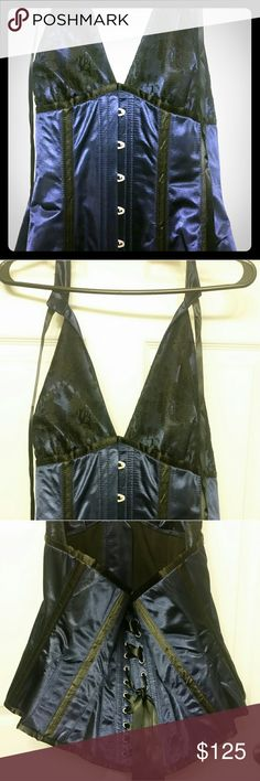 Butterfly corset Beautiful silk feel brocade butterfly shape corset. Never worn. Size uk 38 which is a US bust measurement of 38.  #corset38 #corset     I consider all offers just don't low ball me!   *Comes from a pet friendly, non-smoking home  *I am 5'10, roughly 210-220, Size 12/14 top, size 14 bottoms, with a 40-42 F cup bra.   I will do my best to indicate if an item runs small or large, but this is based on MY measurements not yours. I am NOT responsible for the fit of this item. Tops