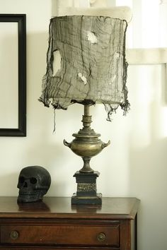 Haunted mansion Halloween lamp / lighting. Great idea and fun! This blog has many good ideas for a hauntingly haute Halloween!