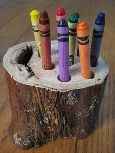 Crayon holder ... love the 'natural' use of a stump - this would be cool for outside to help prevent our crayons from rolling down the cracks in the deck!