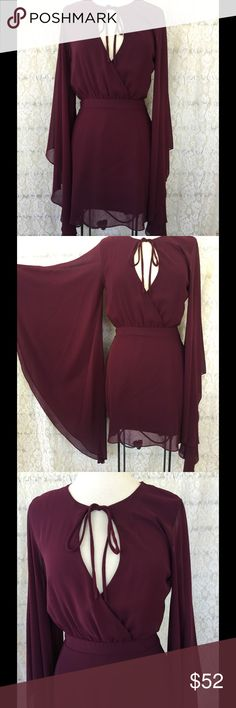 NASTY GAL BOHO CHIC MAROON DRESS This beautiful dress is NWOT SZ Small. Keyhole on the front. Has a slip from waste down. Length: 32 inches Sleeves: 34 inches Slip:16 1/2 inches Nasty Gal Dresses Long Sleeve