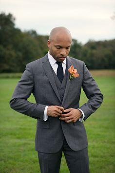 Charcoal grey suit with black tie. Photo by Carla Ten Eyck (via Style Me Pretty).