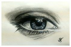 Realistic drawing of an eye. Shading done with pencil and made vibrant using black & grey sketchpens.