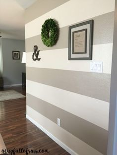 DIY: How to Paint Wall Stripes. This was so easy and made a huge difference in this room. You won't believe the before and after pictures.