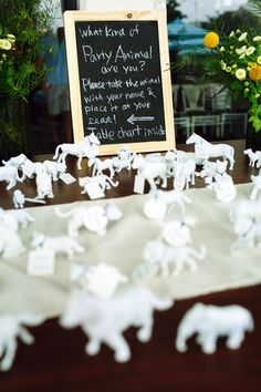 "Creative & alternative escort cards - spray painted animal figurines with a ""Which Party Animal Are You?"" sign! From Misato & Chris' quirky, handmade Northern Virginia wedding at a coffee shop. Images by Love By Serena"