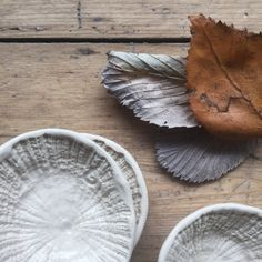 A delicate bowl, hand-formed by pressing soft porcelain into the textured surface of a limpet shell. Each saucer is a tiny bit different and measures approx. 7 or 7.5cm wide x 6.5cm wide. These dishes were designed to hold your go-to jewellery, but each wears a good-safe glaze, so feel