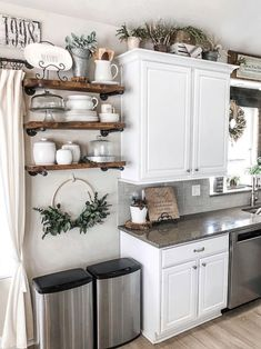 home decor kitchen This open shelving in kitchen is so rustic. I love the way this easy diy industrial project turned out. It add so much to a Joanna Gaines inspired kitchen. The wood shelves and white cabinets compliment each other so well. Farmhouse Kitchen Decor, Kitchen Redo, Home Decor Kitchen, Country Kitchen, New Kitchen, Home Kitchens, Kitchen Remodel, Kitchen Design, Kitchen Cabinets