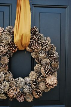 A pinecone wreath is a nice fall welcome!  Change up the color of ribbon to use it for winter too!