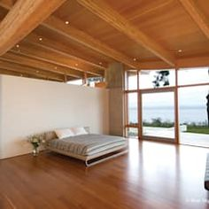 A signature Blue Sky Architecture design, this west coast modern timber frame is built from an integrated system of curved glulam beams and glass. Tv Unit Furniture Design, Tv Unit Design, Tv Unit Decor, Modern Tv Units, Living Room Tv Unit, Modern Spaces, Modern Bedroom, Modern Interior, Living Room Designs