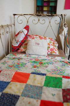 I love this ~ so cozy and cute. Love the sweet vintage sheets & hominess... Colorful, too! :)