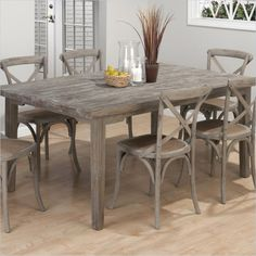 Create a rustic, cottage style dining room with Jofran's solid oak dining table. The burnt gray finish adds a hint of understated sophistication.