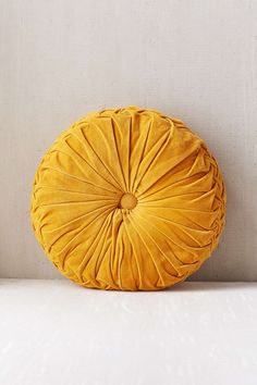 I love this Round Pintuck Pillow from Urban Outfitters! Kind of vintage-looking but so chic and fun!