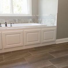 Flooring: Angora, Curx, 12x24; Tub Surround: Angora Ottomano, Porcelain Tile, 12x12, Argento; Accent: Hexagon, Sage; Grout: Pewter