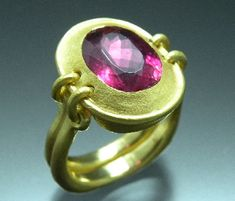 jewelry image of Vetus Design - 22k gold set with a natural hot pink tourmaline stone with a faceted oval cut and completed with a distressed surface texture