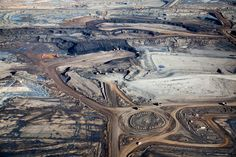 9 | See The Devastated Landscape Of The Alberta Tar Sands From 1,000 Feet Above | Co.Exist | ideas + impact Excavating bitumen at the Syncrude Mildred Lake mining site. Giant tires line traffic circle.
