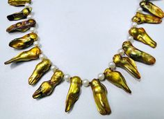 Vintage golden mother of pearls beads pendant by TRIBALEXPORT, $399.00