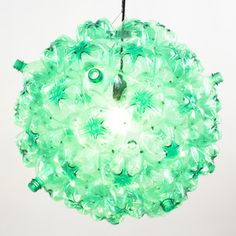 Bubble Chandelier Green Black, $655: Inspired by the cell-like shape of soap bubbles, Bubble Chandelier by Souda is created from 60 used plastic bottles that are cleaned, cut, and riveted together to form a self-supporting sphere. The bottles are provided by Sure We Can, a non-profit that runs the only homeless-friendly can and bottle redemption center in New York City. Souda donates a portion of the proceeds from each Bubble Chandelier to help improve the conditions of Sure We Can's…