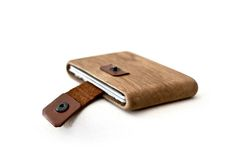 Handmade using one piece of oak wood and vegetable tanned leather. It's  unique number will be written at the backside, and you will recieve a  certificate for your edition.  ALL PRODUCTS
